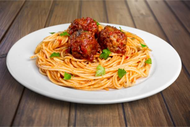 Spaghetti. pasta with meatballs and parsley with tomato sauce spaghetti stock pictures, royalty-free photos & images