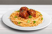 pasta with meatballs and parsley with tomato