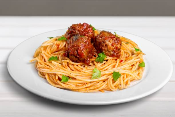 Spaghetti. pasta with meatballs and parsley with tomato spaghetti stock pictures, royalty-free photos & images