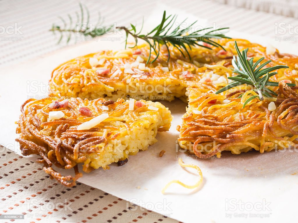 Spaghetti pizza with salami and cheese stock photo