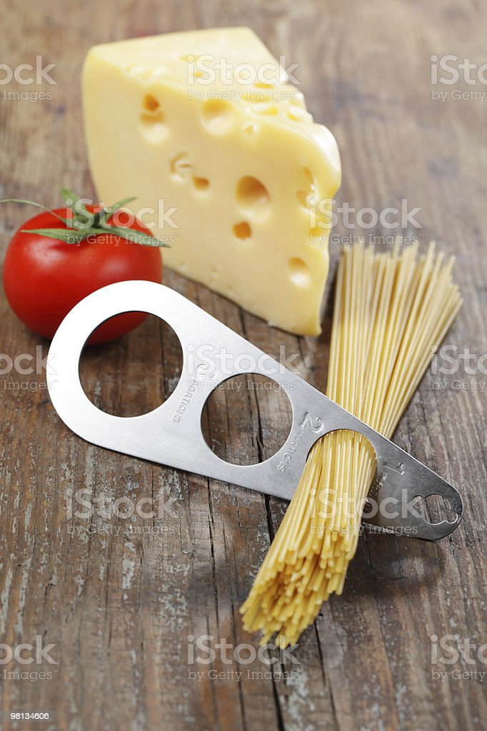 Spaghetti portioner and cheese royalty-free stock photo