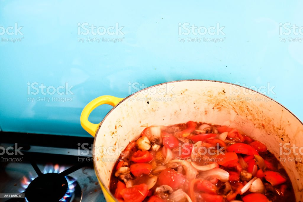 Spaghetti sauce simmering in pan on gas stove royalty-free stock photo