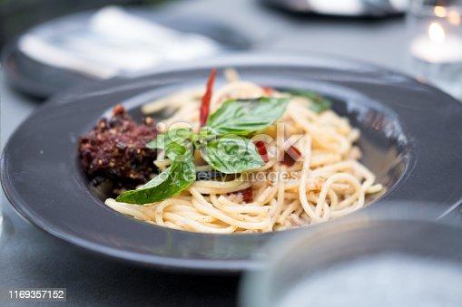 istock Spaghetti stir fried with spicy pork (Thai language Pad Kee Mao) 1169357152