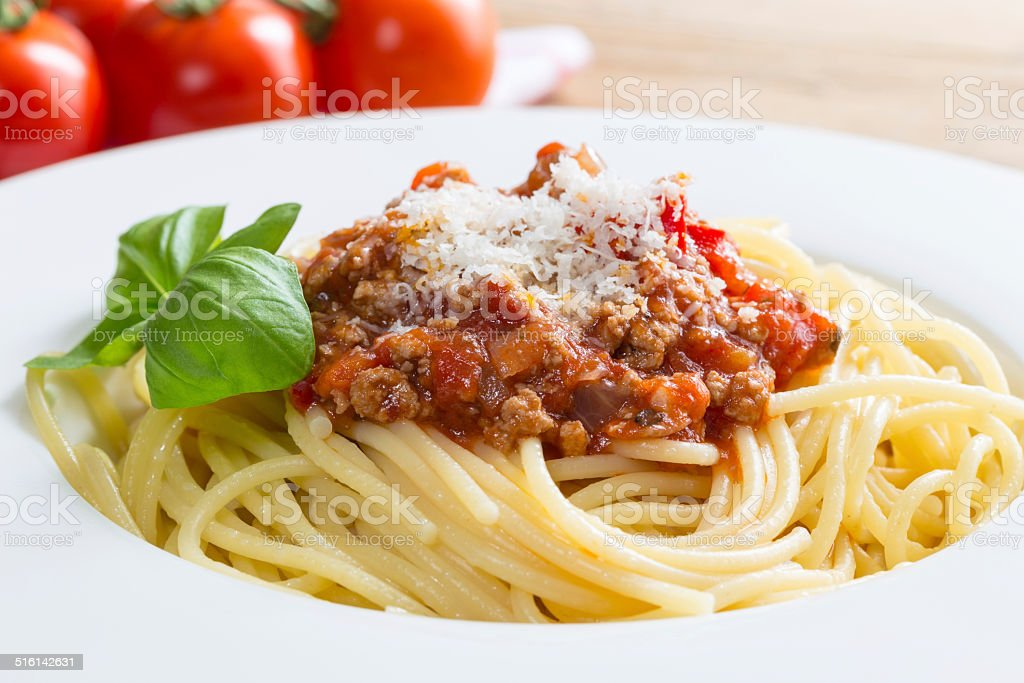 Spaghetti with Bolognese Sauce Parmesan and basil stock photo