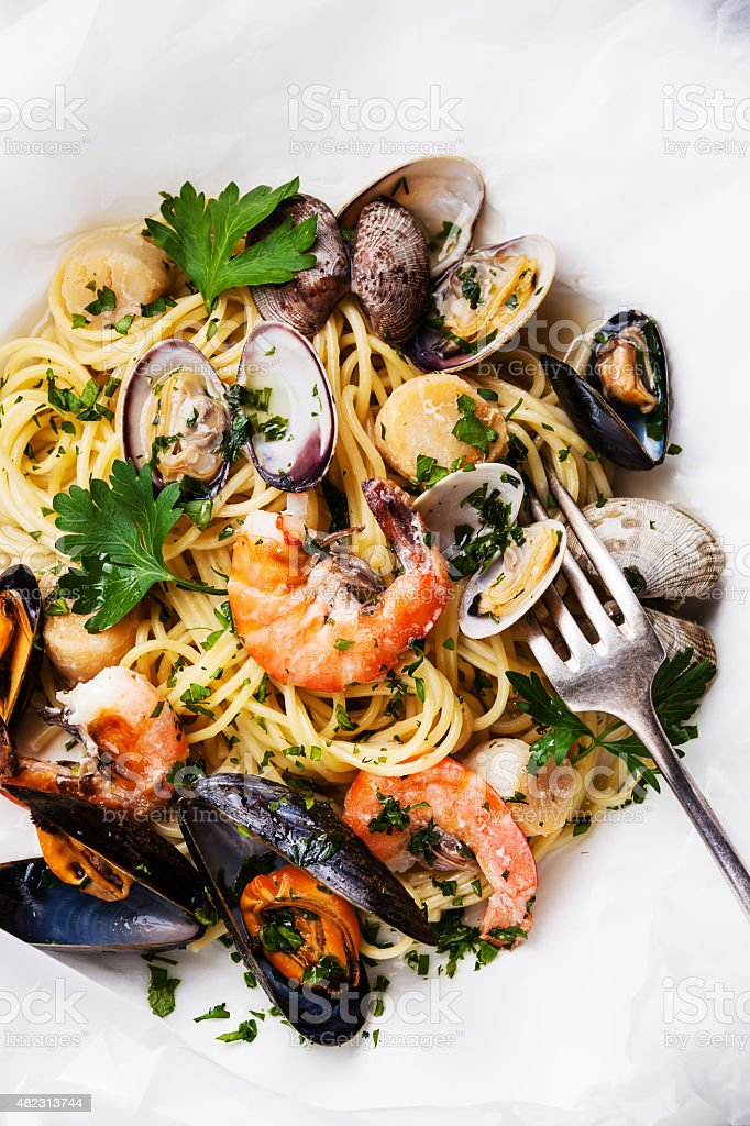 Spaghetti with clams, prawns, sea scallops stock photo