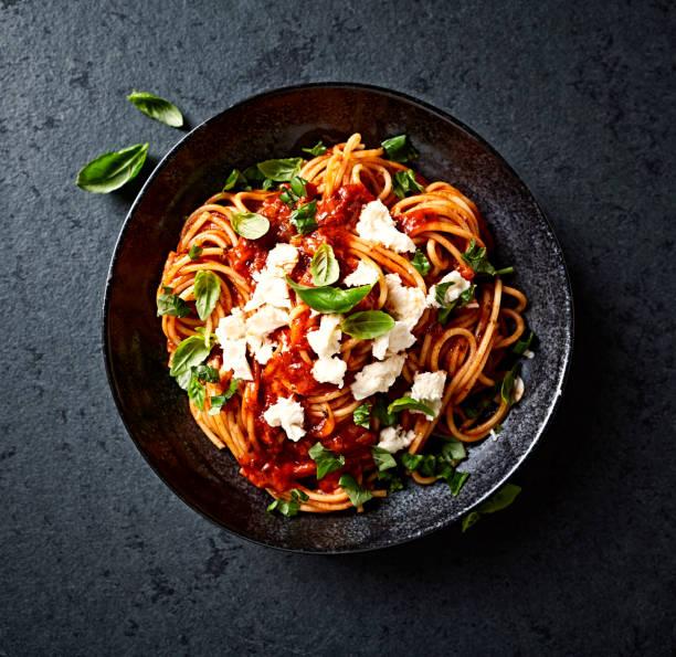 Spaghetti with fresh Tomato Sauce, Mozzarella and Basil ( seen from above) stock photo