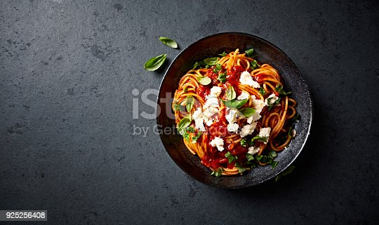 istock Spaghetti with fresh Tomato Sauce, Mozzarella and Basil ( seen from above) 925256408
