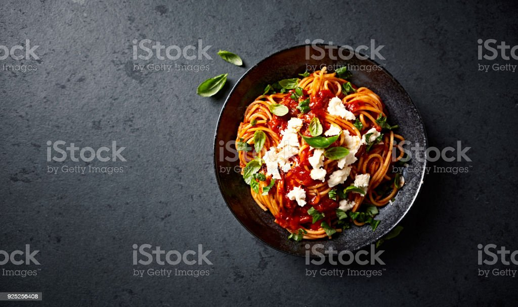 Spaghetti with fresh Tomato Sauce, Mozzarella and Basil ( seen from above) stock photo