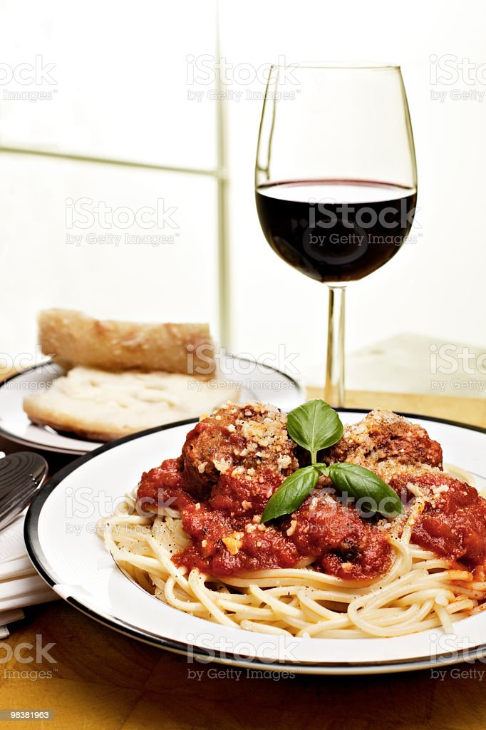 Spaghetti with meatballs, bread and red wine royalty-free stock photo