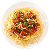 Spaghetti with meatballs with tomato sauce and cheese. Isolated on white background. View from above.