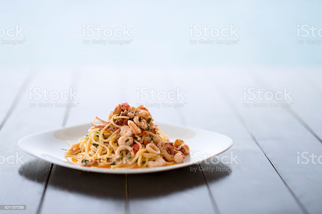 Spaghetti with Mixed Raw Seafood Plate by the Sea stock photo