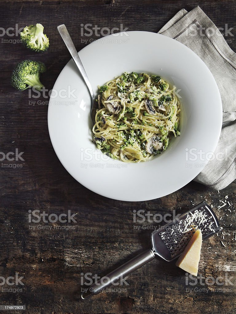 Spaghetti with mushrooms, broccoli and cheese stock photo