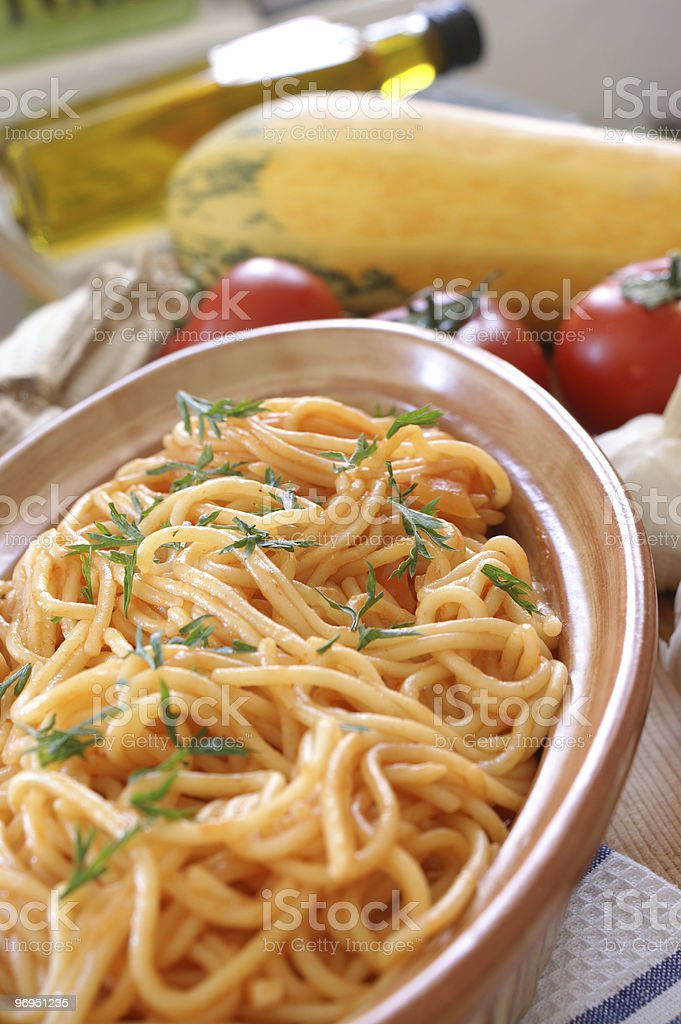 Spaghetti with organic tomato sauce and parsley royalty-free stock photo