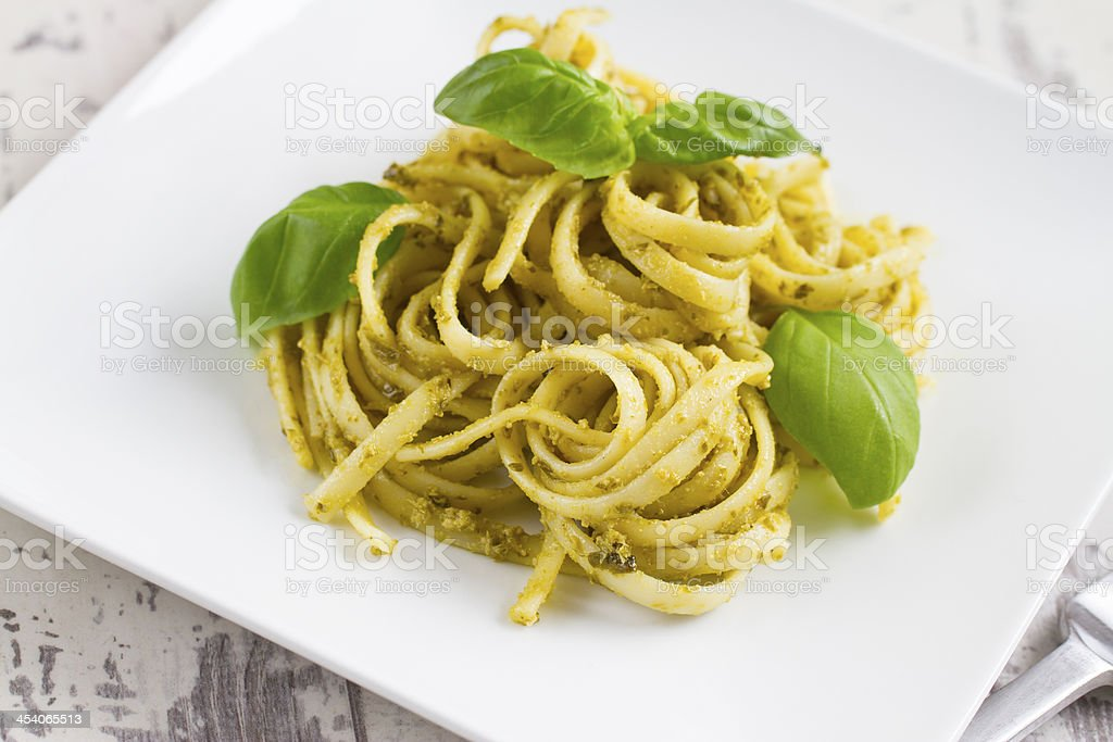 Spaghetti with Pesto and Basil royalty-free stock photo