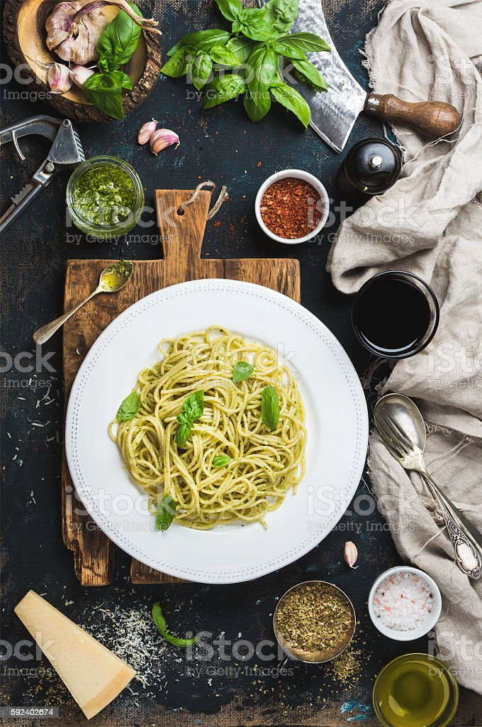Spaghetti with pesto sauce, parmesan cheese, basil and wine stock photo
