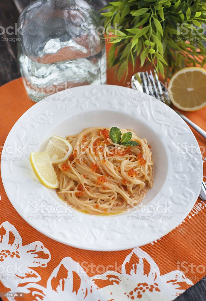 Spaghetti with red caviar stock photo