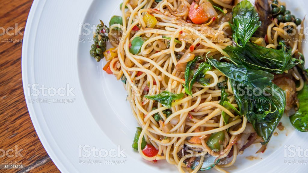 Spaghetti with Spicy Mixed Seafood, Thai Style. stock photo