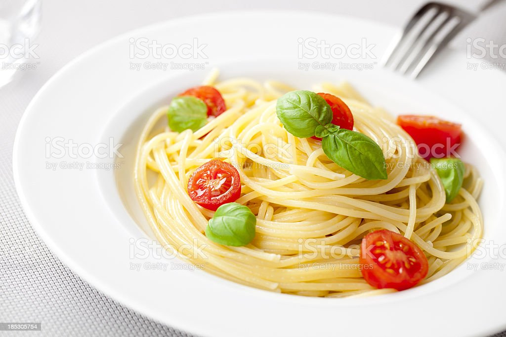 Spaghetti with tomato and basil royalty-free stock photo