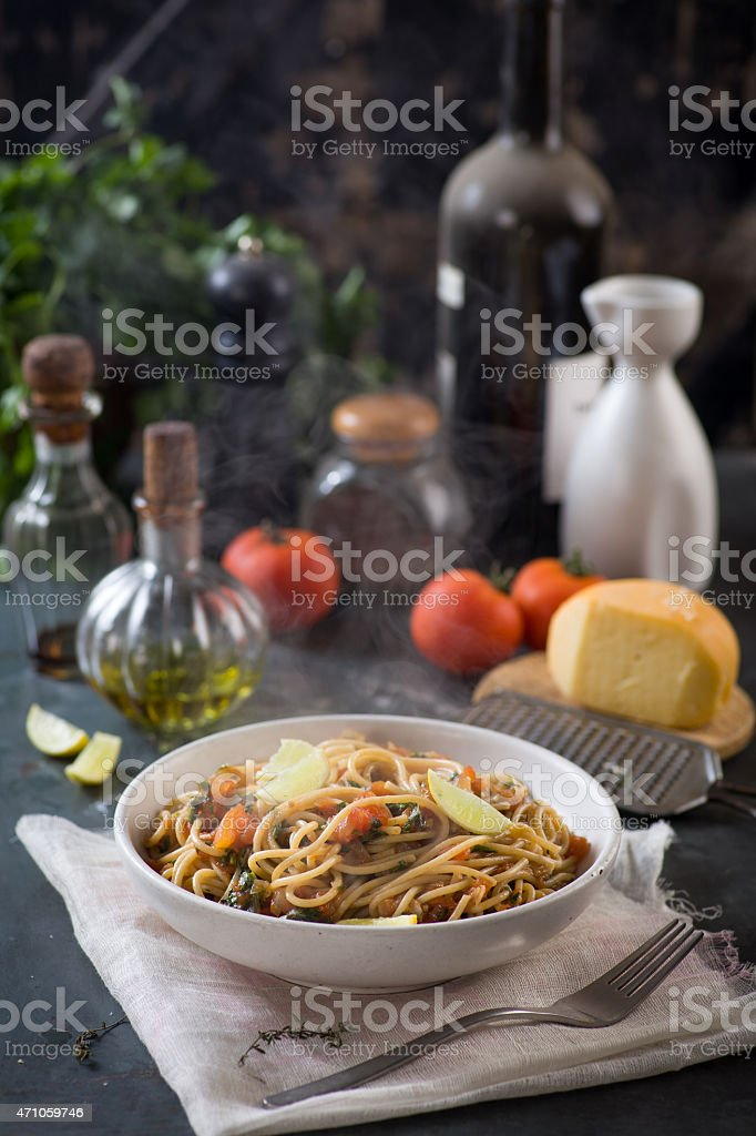 spaghetti with tomato sauce, herbs and lemon stock photo