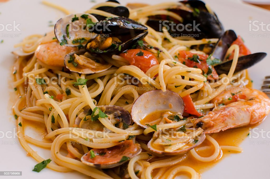 Spaghetti con frutti di mare tipical italian food stock photo