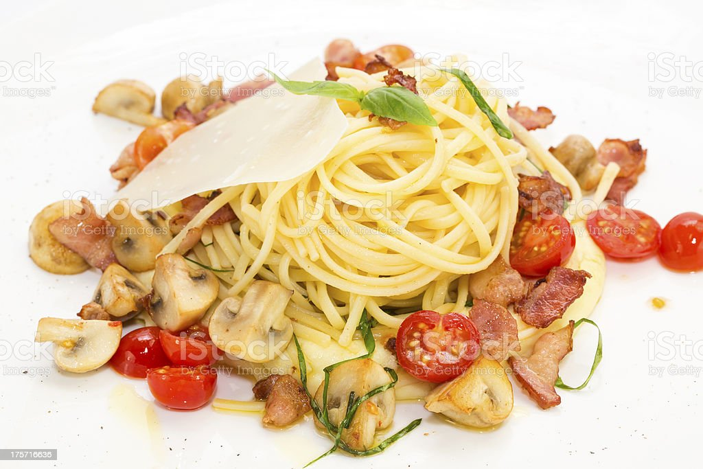 spaghetti with vegetables and bacon royalty-free stock photo