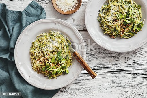 Spaghetti with vegetables, spinach, nuts and parmesan