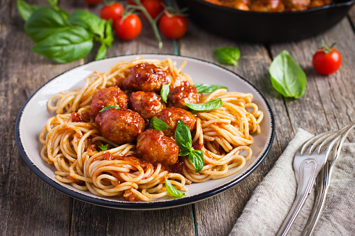 Spaghetty pasta  with meatballs and tomato sauce,  selective focus