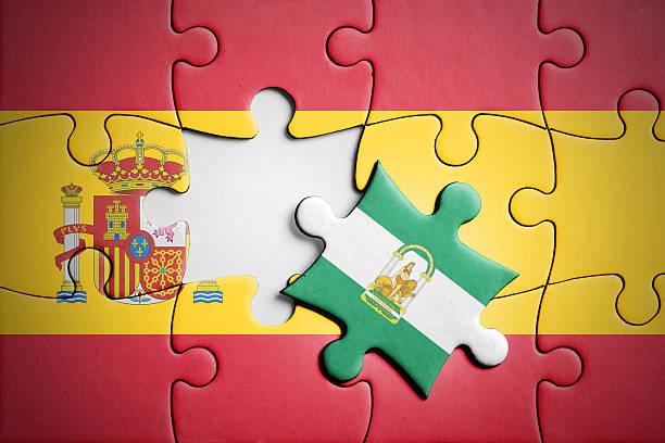 spain and andalusia. separatism concept puzzle. - andalusian flag fotografías e imágenes de stock