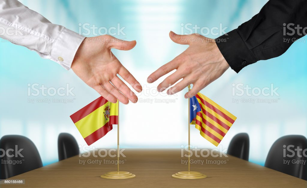 Spain and Catalonia diplomats shaking hands to agree deal stock photo