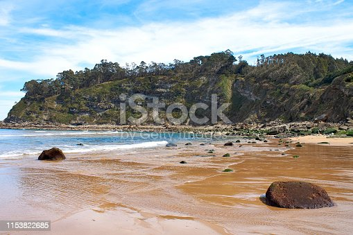Beach and cliff in España beach in Asturias, Spain.