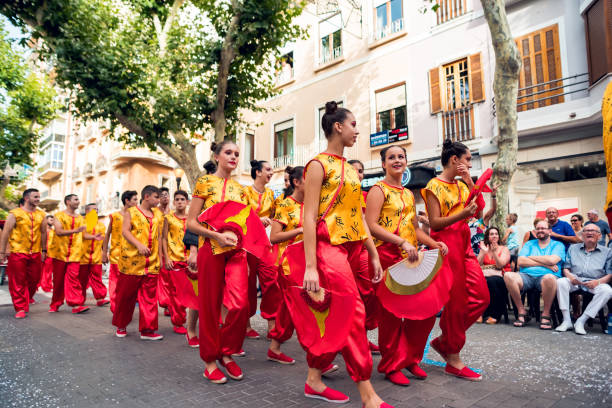 Spain Denia the 13th of July 2019 People in carnival. Summer celebrations in the city of Denia Alicante, a group of people a group of people goes and dressed in japanese style stock photo