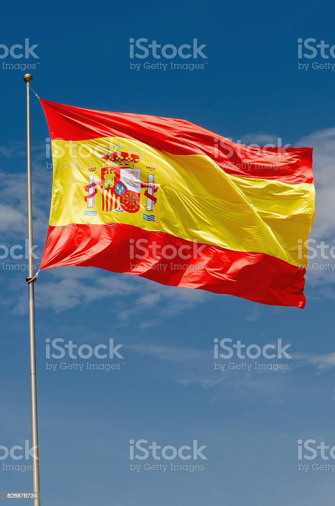 Spain flag waving on the sky - foto de acervo