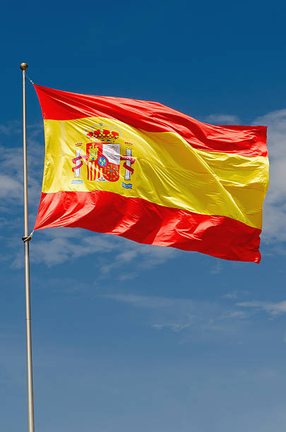 Spain flag waving on the sky - foto de acervo