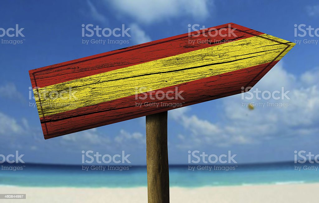 Spain flag wooden sign with a beach on background stock photo