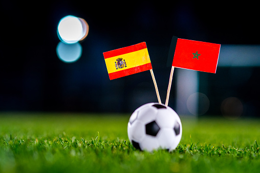 Spain - Morocco, Group B, Monday, 25. June, Football, World Cup, Russia 2018, National Flags on green grass, white football ball on ground.