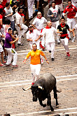 Pamplona Navarra Spain July 11 2015 S Firmino fiesta People running with bull in the ENCIERRO early in the morning. the route is used to bring the bulls in the arena for the afternoon bullfight is a deeply rooted celebration held annually 6 July, with opening is the pyrotechnic chupinazo 14 July