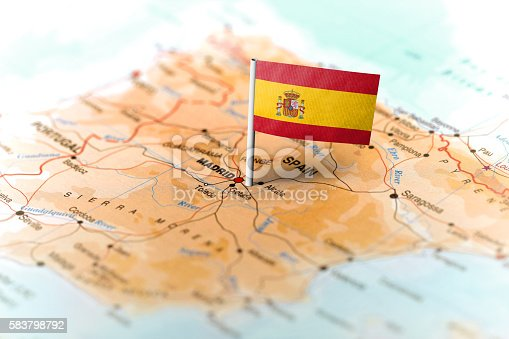 istock Spain pinned on the map with flag 583798792
