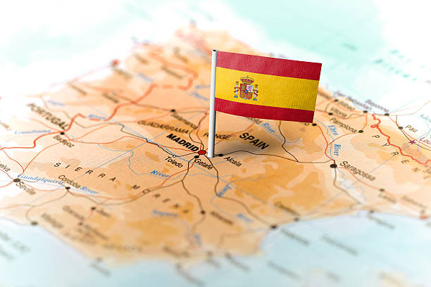spain pinned on the map with flag - espagne photos et images de collection