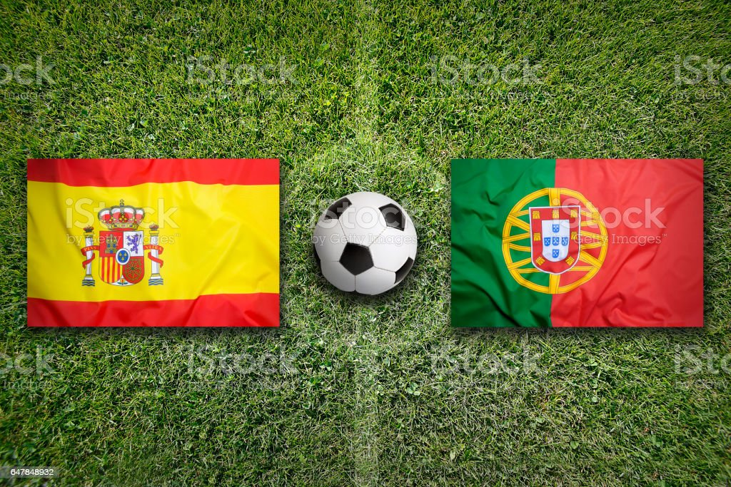 Spain vs. Portugal flags on soccer field - foto stock