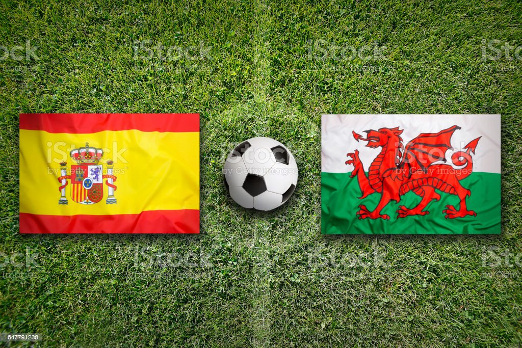 Spain Vs Wales Flags On Soccer Field Royalty Free Stock Photo