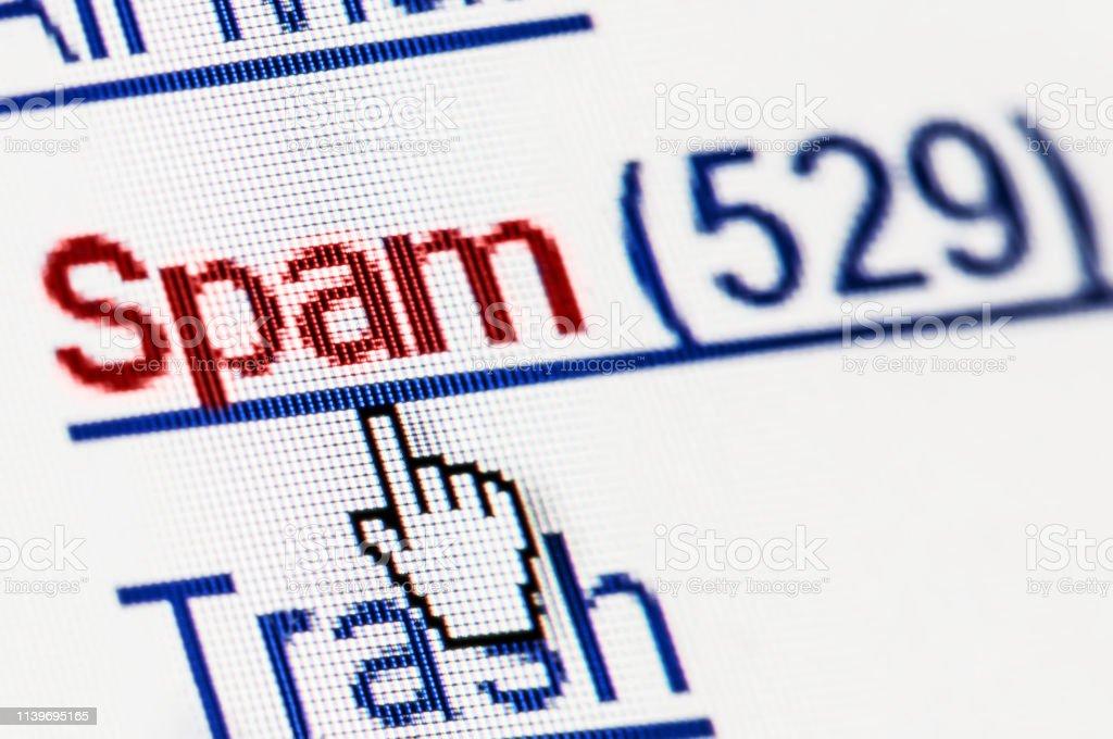 Spam junk e-mail box on pixelated computer screen. Macro shot
