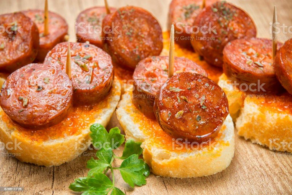 Spanish appetizer, sausage stock photo