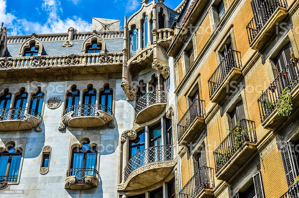 Spanish balconies with creative windows and shutters stock photo