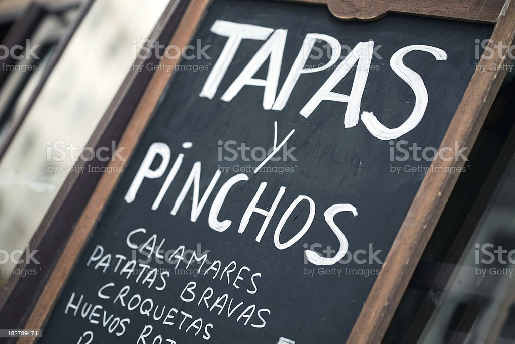 Spanish bar chalkboard featuring tapas y pinchos stock photo