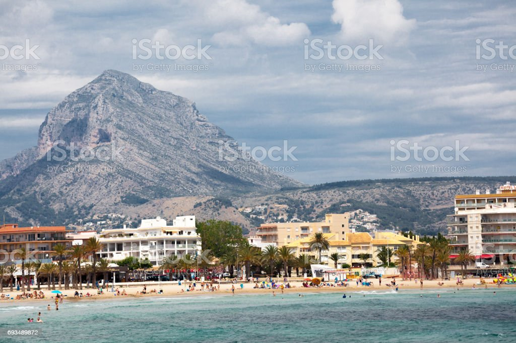 spanish beach on cocta blanca with mountain on sunny day stock photo