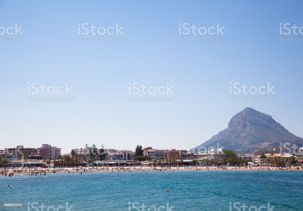 spanish beach on costa blanca with mountain on sunny day stock photo