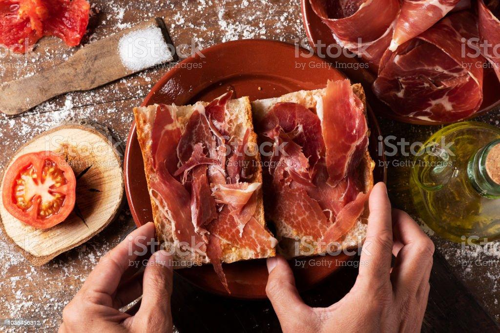 spanish bocadillo de jamon, serrano ham sandwich stock photo