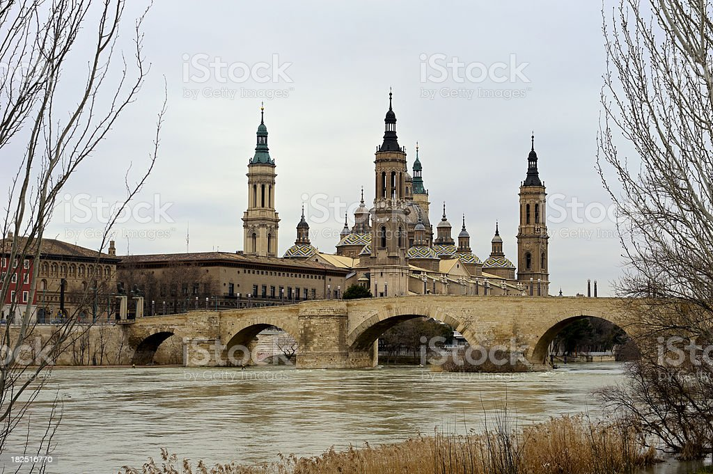 Spanish building. Zaragoza View of the Cathedral of Zaragoza called El Pilar and the Ebro River (Spain). Architecture Stock Photo