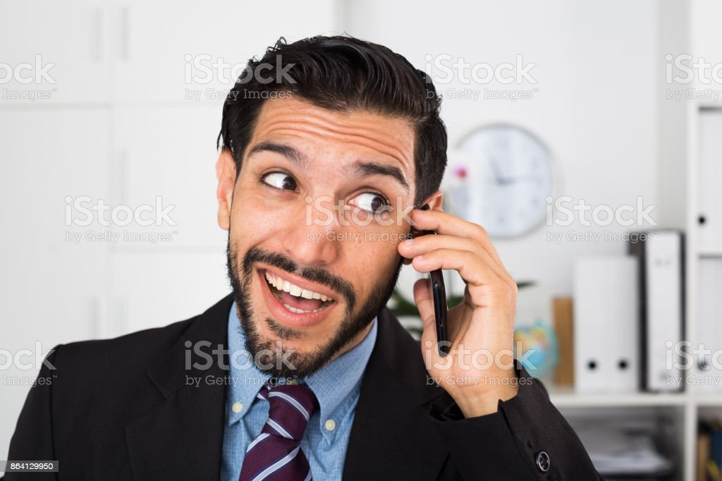 Spanish businessman is excited while talking phone royalty-free stock photo