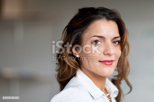 istock Spanish Businesswoman Serious At the Camera. At the office. 635909092